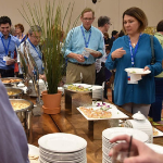 Attendees eating breakfast during a Nierman Seminar Break