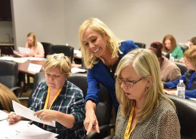 Rose Nierman helping a CrossCoding attendee at a Medical Billing CE Course