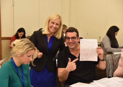 Rose Nierman with a Cross-Coding attendee during a medical billing/cross-coding ce Course