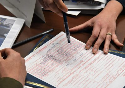 Filling out a Health insurance claim form during a medical billing/ cross-coding ce course