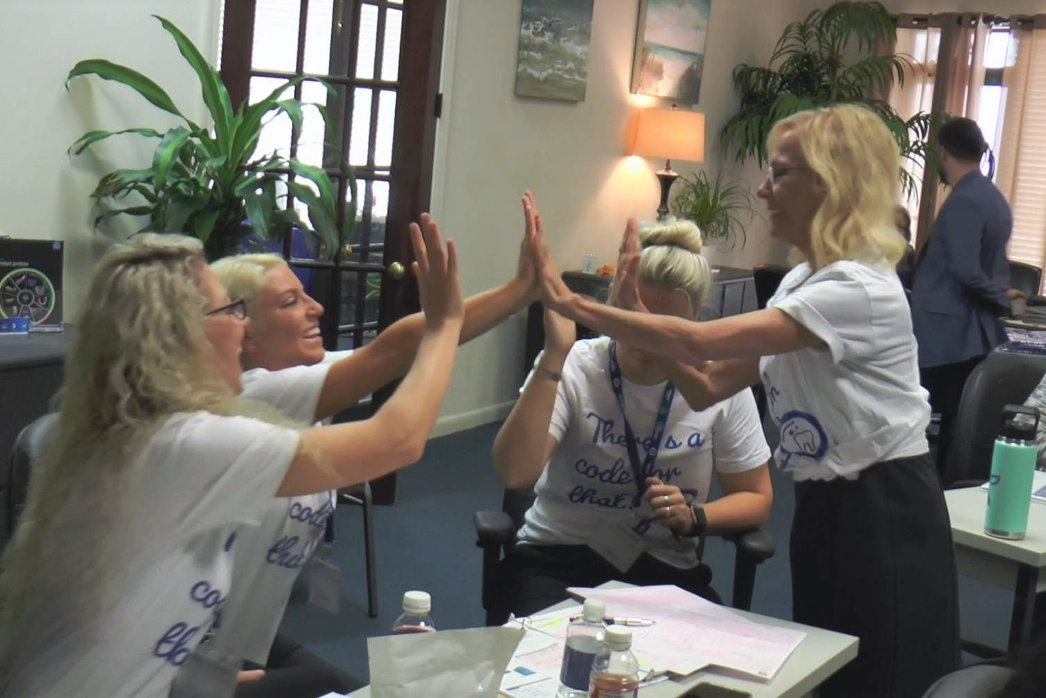 Medical Billing in Dentistry Course Attendees High Five with Rose Nierman
