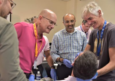 Dr. Mayoor Patel with practitioners learning during the dental sleep medicine CE Course