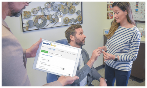 Dentist using DentalWriter Software to help patient with sleep appliance