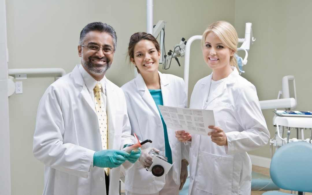 Dentists performing oral cancer screenings