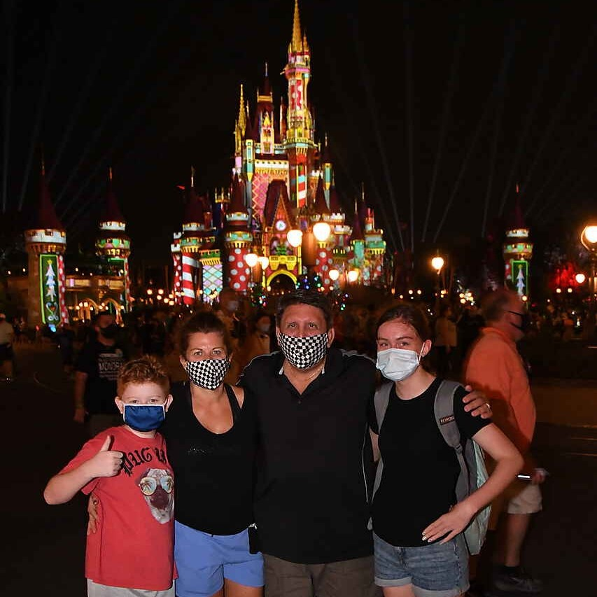 Raeanne with family at Disney