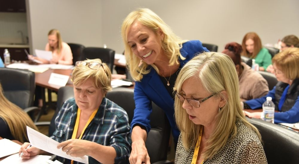 Rose Nierman helping Cross Coding Attendee