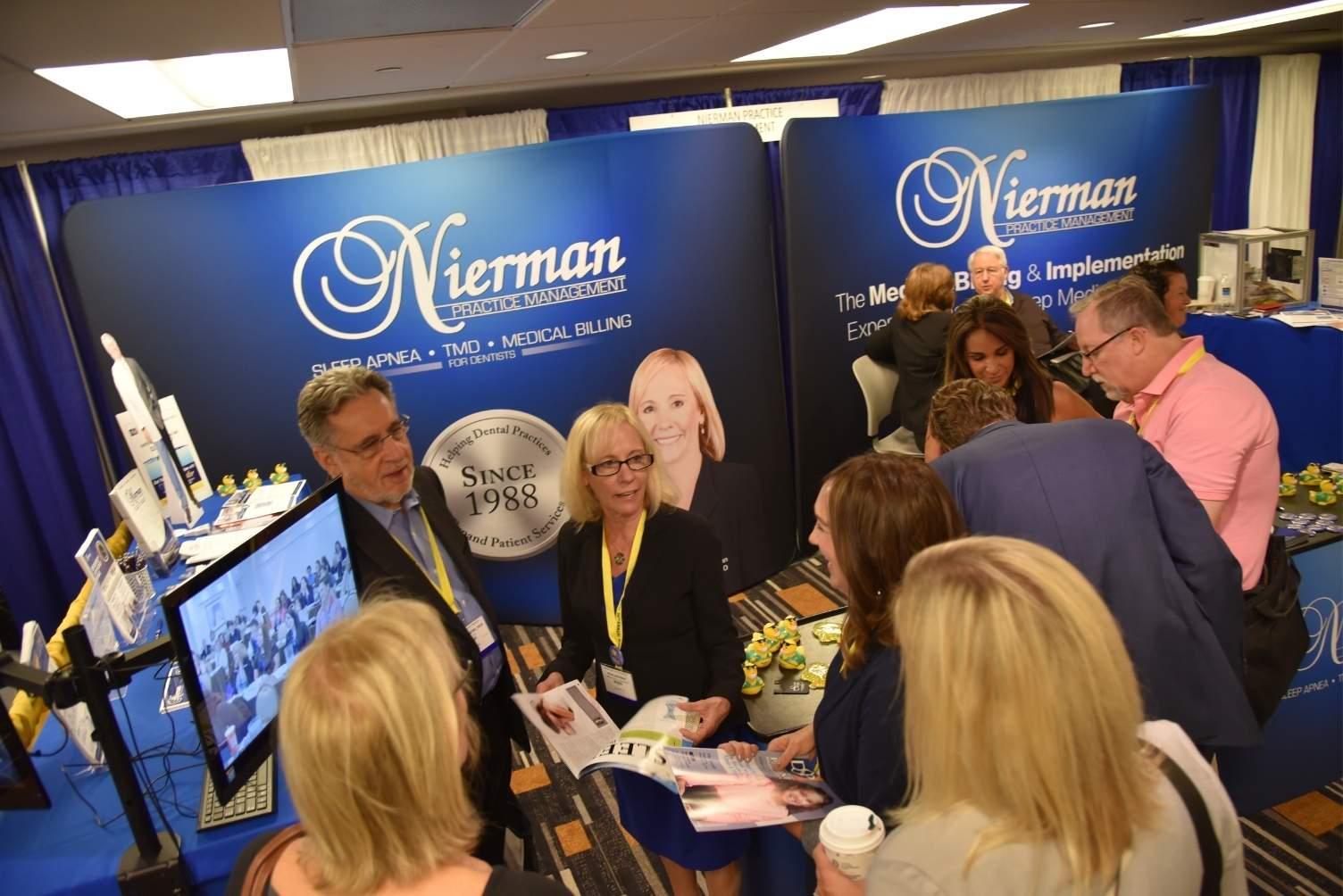 Rose Nierman at the Nierman Booth during the AADSM Annual Meeting